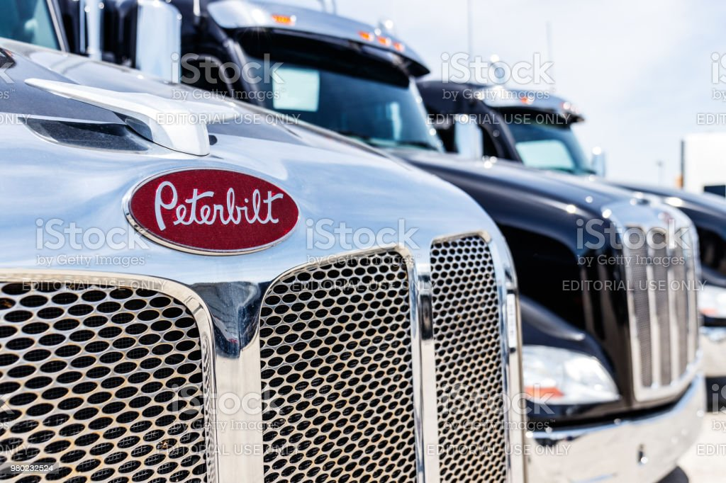 Peterbuilt Semi Tractor Trailer Trucks Lined up for Sale. Peterbuilt is owned by Paccar II stock photo