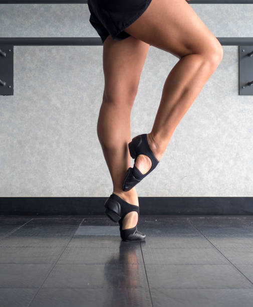 Peti Retire at the barre in T strap Jazz Shoes in dance class stock photo