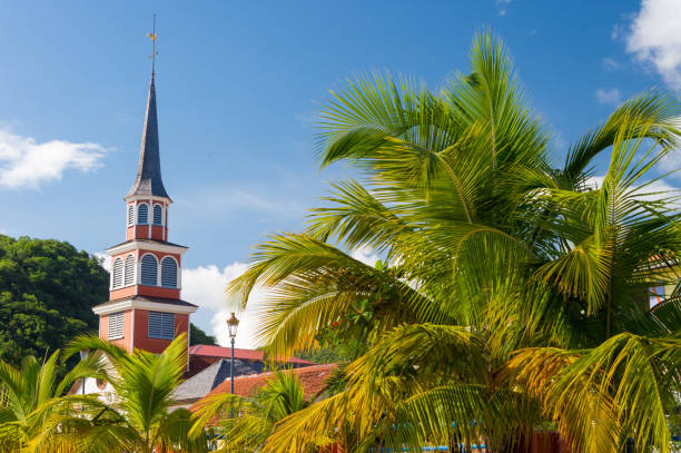 Petite Anse d'Arlet village, with Saint Henri Church and palm trees stock photo