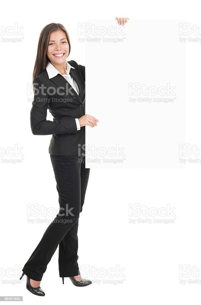 Petite professional holding blank, editable sign royalty-free stock photo