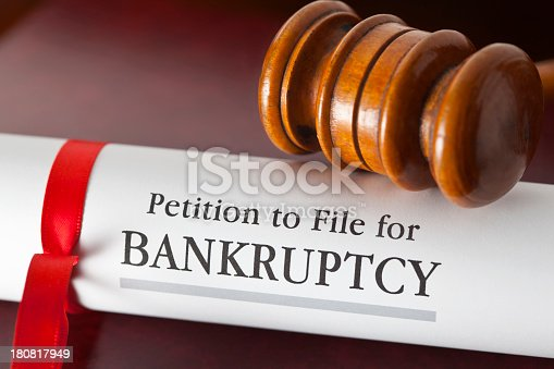 istock Petition to file for bankruptcy under a gavel 180817949