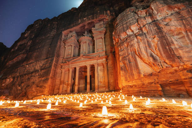 Petra by night, Treasury ancient architecture in canyon, Petra in Jordan. 7 wonders travel destination in Jordan stock photo