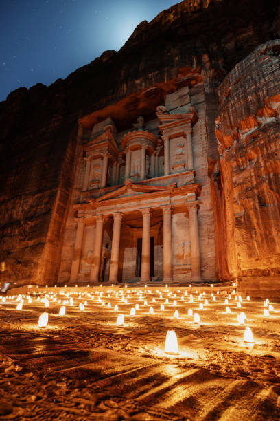 Petra by night, Treasury ancient architecture in canyon, Petra in Jordan stock photo