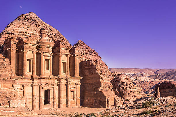 Petra monastery, Jordan Jordan, Petra: the Monastery / Ad Deir and its cliff - donkeys outside - UNESCO world heritage site - photo by M.Torres monastery stock pictures, royalty-free photos & images