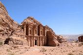 Monastery in Petra (Jordan) over a blue sky.