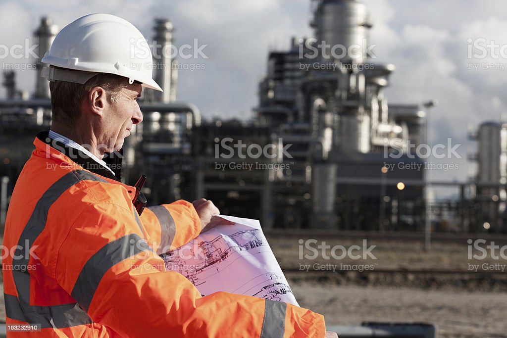 Petrochemical inspector with drawing foto