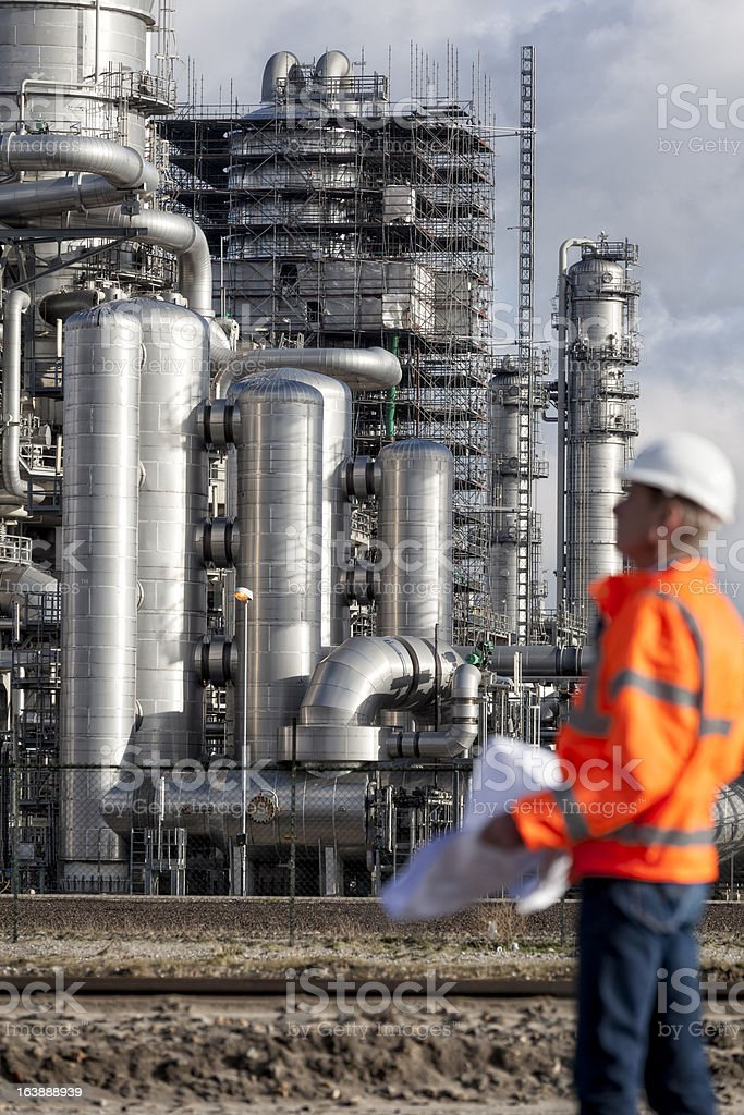 Petrochemical inspector with drawing stock photo