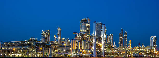 petrochemical plant at dusk - refinery stock photos and pictures
