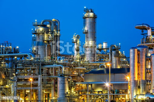 Petrochemical plant illuminated at twilight