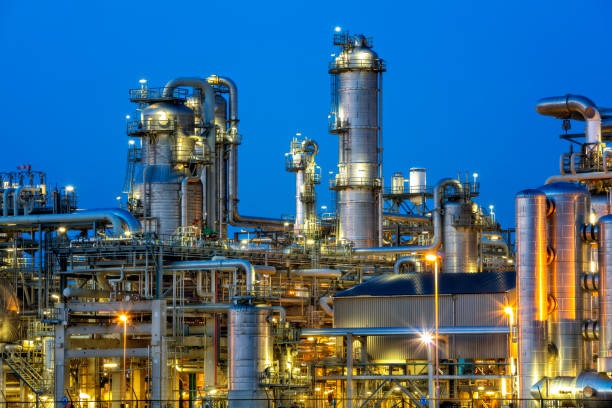 Petrochemical plant at twilight Petrochemical plant illuminated at twilight chemical plant stock pictures, royalty-free photos & images