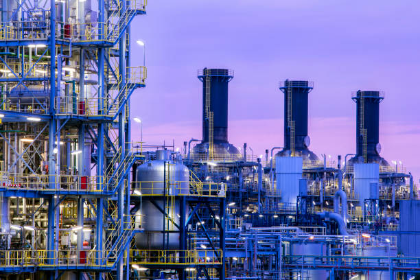 Petrochemical plant at twilight Petrochemical plant at dusk chemical plant stock pictures, royalty-free photos & images