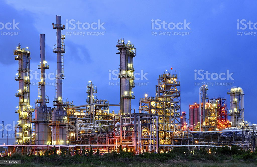 Petrochemical plant skyline at dusk stock photo