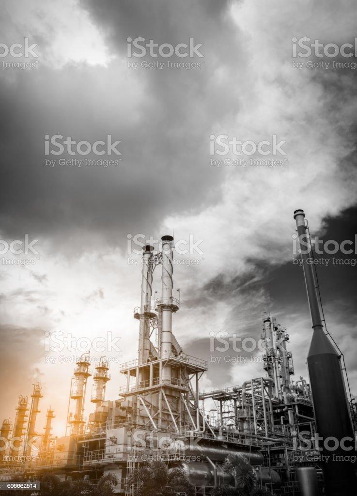 petrochemical plant (black & white image) with rain cloud stock photo