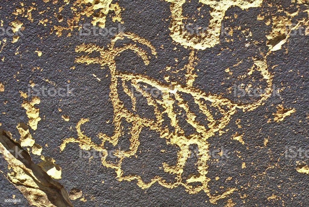 Petroglyph of animal royalty-free stock photo