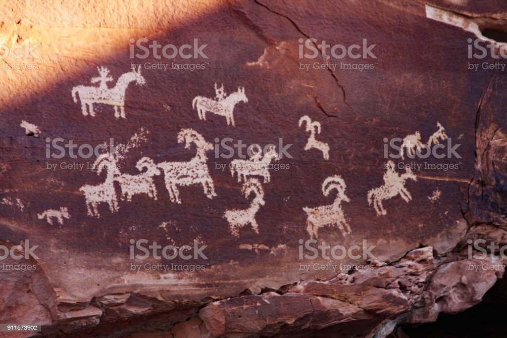 Petroglyphs depict big horn sheep stock photo
