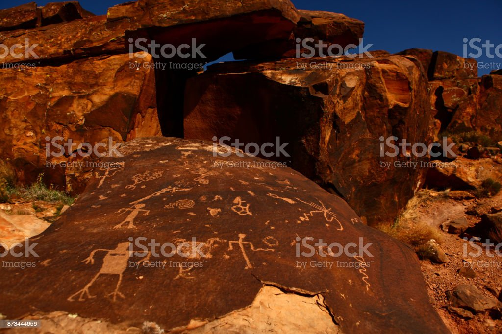 petroglyphs in desert sandstone stock photo