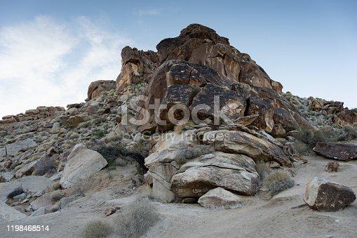 Petroglyphs in desert on boulders taken in Nevada
