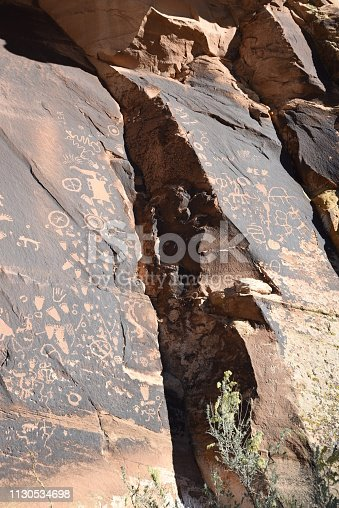 Prehistoric petroglyphs survive on Newspaper Rock in the Needles area of Canyonlands National Park, Utah.