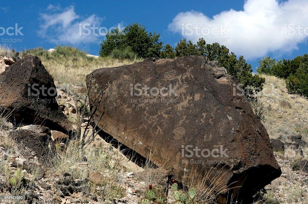 Petroglyphs on rock stock photo