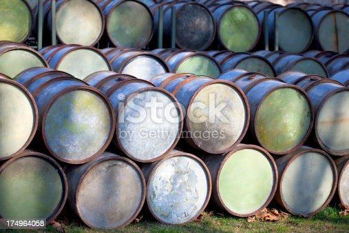 rusty blue petrol barrels in shade