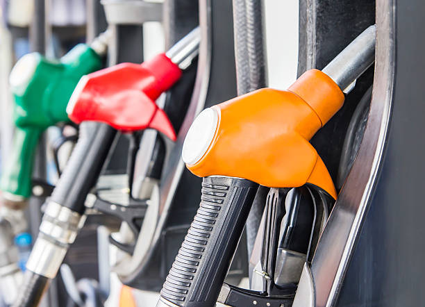 Petrol pump filling stock photo