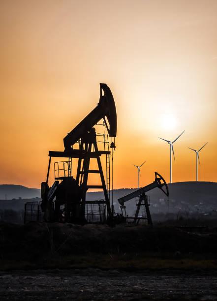 petroleum pump and windmills stock photo
