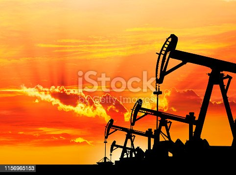 Dawn over petroleum pumps in the desert