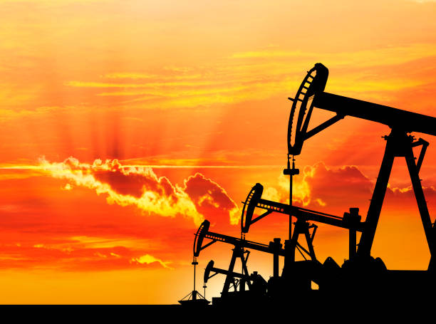 Petroleum pumps in the desert at dawn stock photo