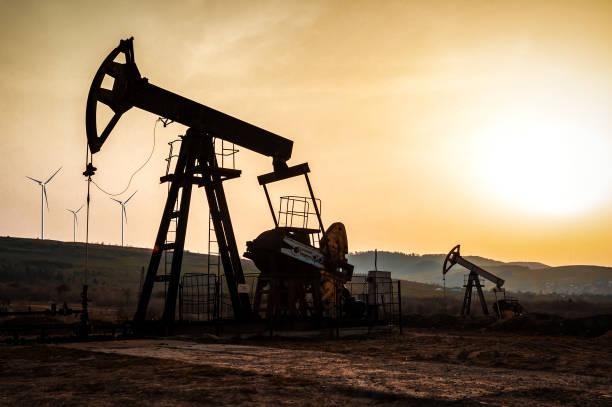 petroleum pumps on sunset stock photo