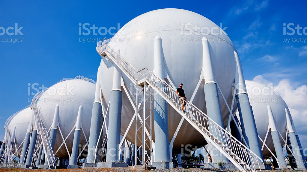 Petroleum Storage Tanks and a worker stock photo