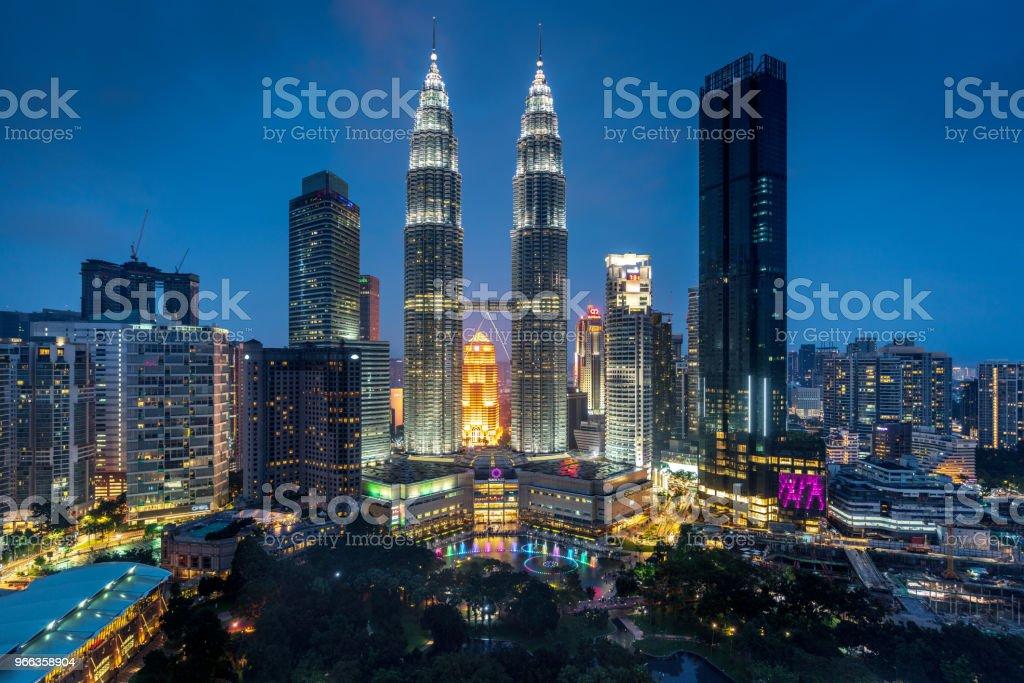 Petronas Towers by Night Kuala Lumpur Malaysia View towards the iconic Petronas Towers in downtown Kuala Lumpur at Night from above. Kuala Lumpur, Malaysia Architecture Stock Photo