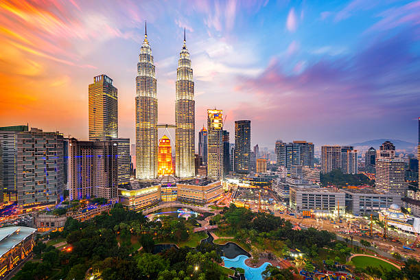 petronas towers. - malaysia stock photos and pictures