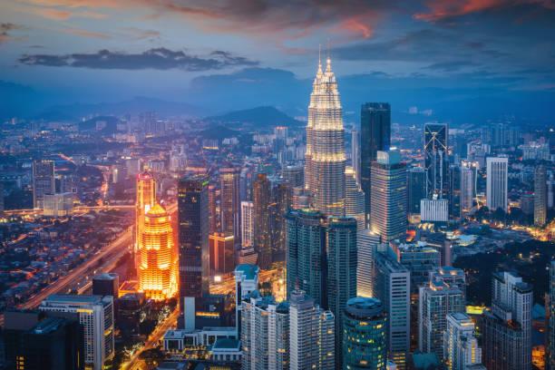 Petronas Twin Towers Sunset Twilight Kuala Lumpur Illuminated Cityscape stock photo