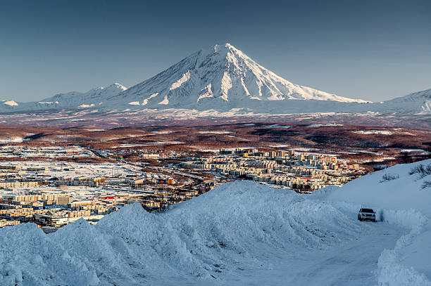 Petropavlovsk-Kamchatsky cityscape and Koryaksky volcano Petropavlovsk-Kamchatsky cityscape and Koryaksky volcano at sunrise. Far East, Russia kamchatka peninsula stock pictures, royalty-free photos & images