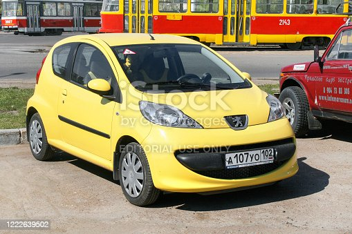 Ufa, Russia - April 28, 2008: Yellow city car Peugeot 107 in the city street.