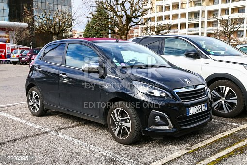 Annecy, France - March 13, 2019: Black compact car Peugeot 108 in the city street.
