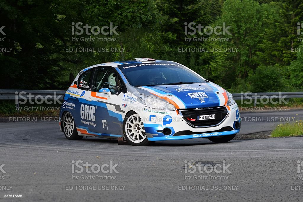 Peugeot 208 driving on the road stock photo