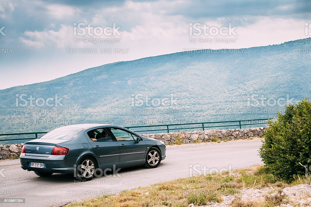 Peugeot 407 car on background of French mountain nature landscape stock photo