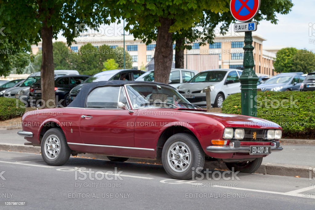 Peugeot 504 convertible Epernay, France - July 23 2020: The Peugeot 504 is an automobile of the French car manufacturer Peugeot. This version is a convertible designed by Pininfarina. Car Stock Photo