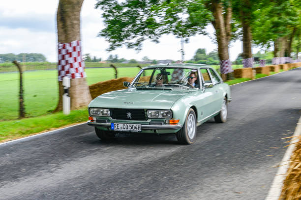 Peugeot 504 Coupe classic car driving on a country road - foto stock