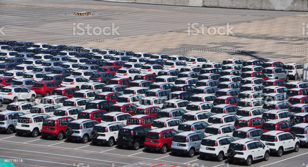 Peugeot and Citroen cars awaiting delivery on the pier stock photo