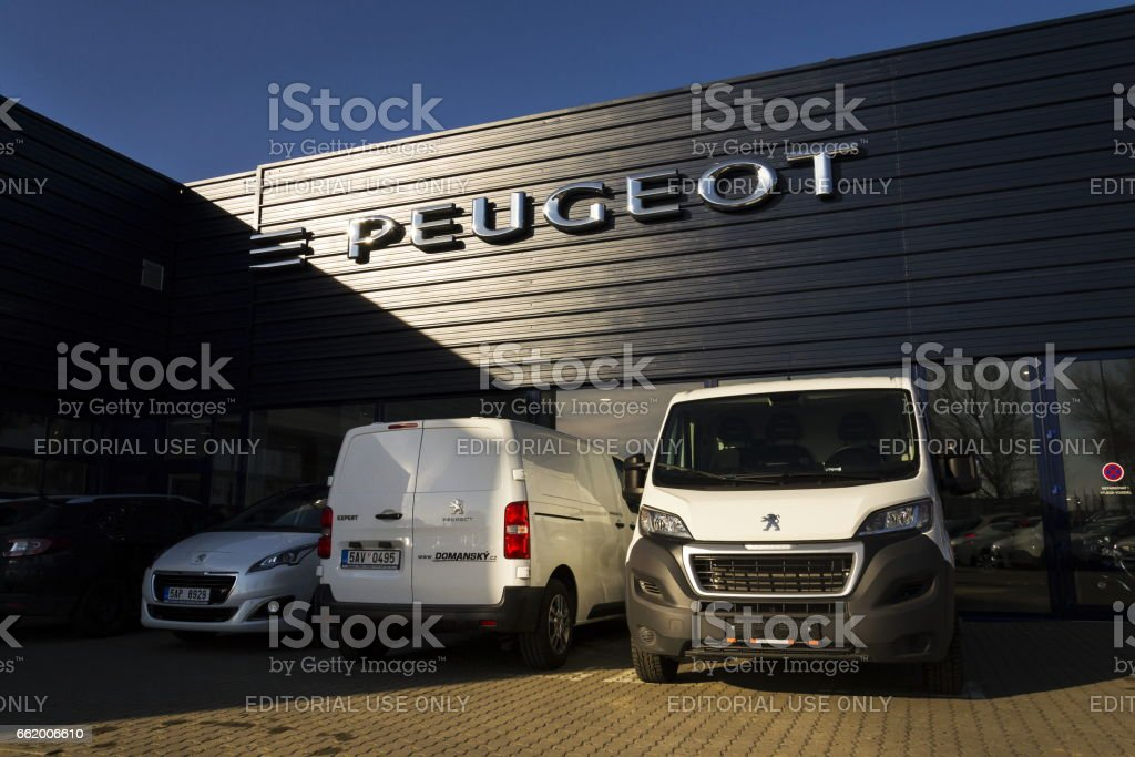 Peugeot car company logo in front of dealership building royalty-free stock photo