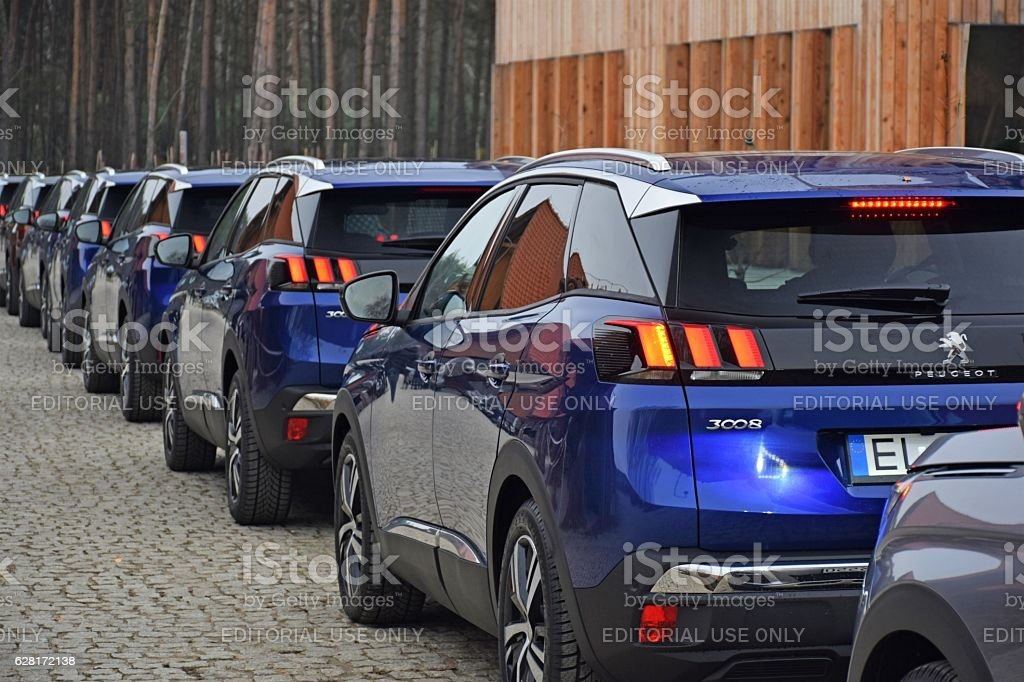 Peugeot vehicles on the parking stock photo