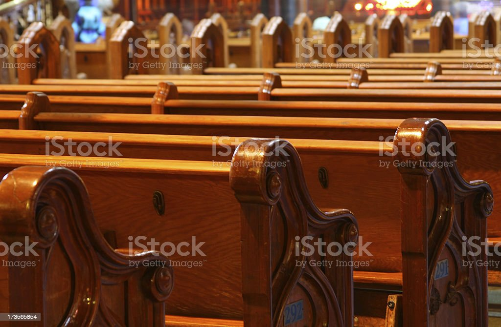 Pew rows in an old church (close-up) royalty-free stock photo