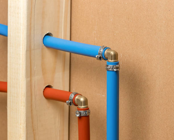 Pex plastic water supply plumbing pipe in wall of house. Concept of home repair, maintenance and remodeling stock photo