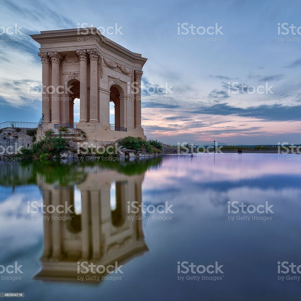 Peyrou Pavilion in Montpellier with reflection and sunset colors stock photo