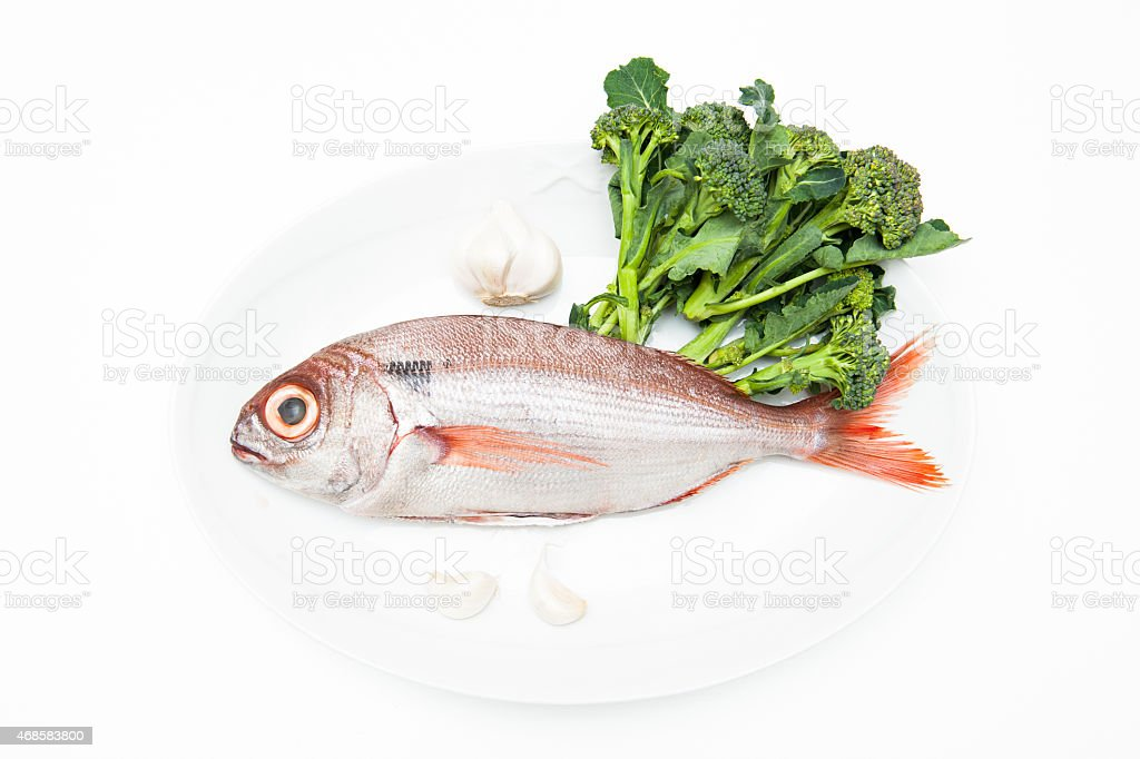 Pezzogna fish, variety of sea bream, with spice white background stock photo