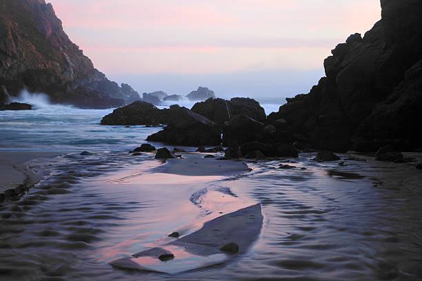 Pfeiffer Beach Rocks, Purple Sand and Sunset stock photo