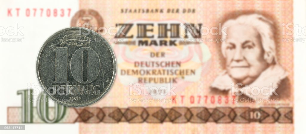 10 pfennig coin against historic 10 east german mark bank note zbiór zdjęć royalty-free