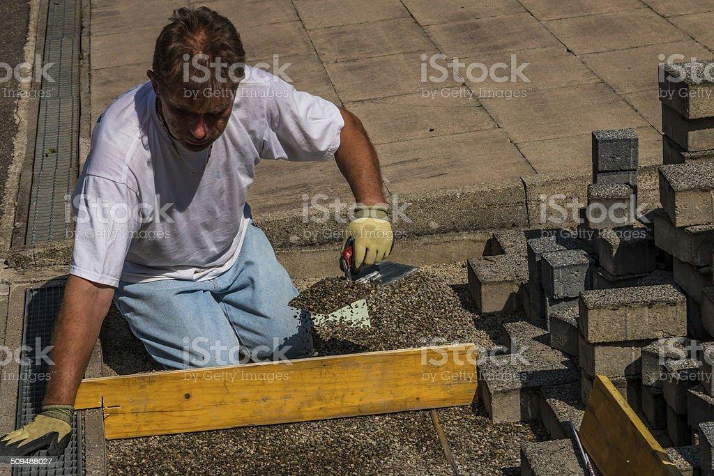 Pflastersteine verlegen stock photo